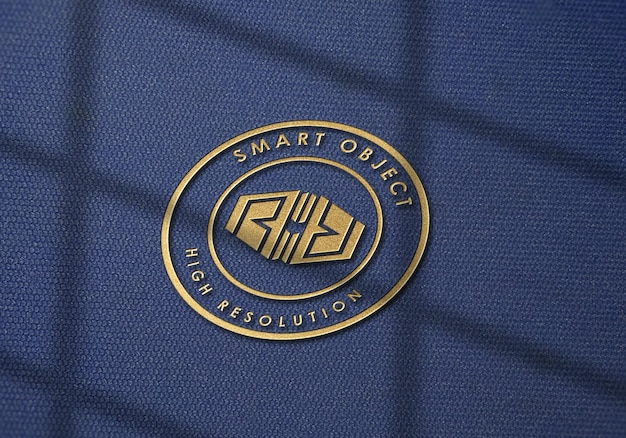 Logo mockup on denim fabric texture with gold effect