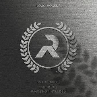 Премиум дизайн макета логотипа с текстурой ткани