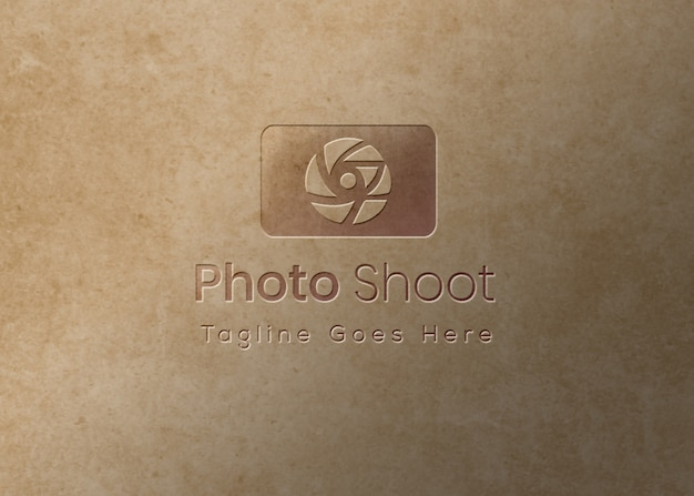 Логотип макет рельефный эффект на фоне текстуры