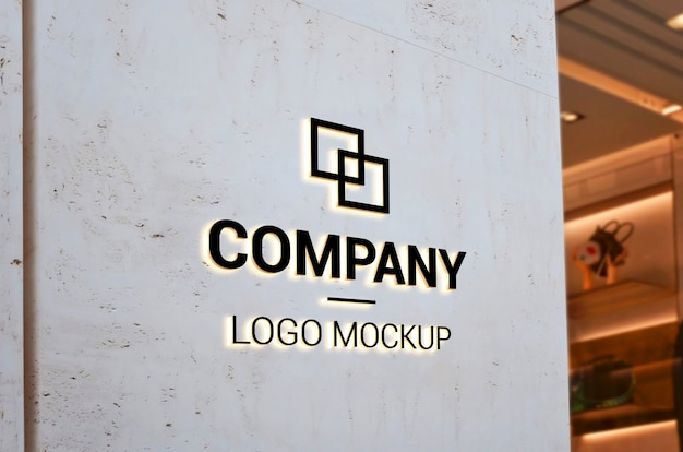 Logo mockup on empty entrance wall with light. branding