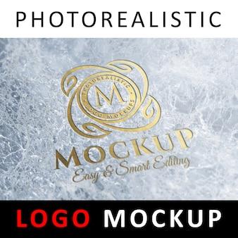 로고 이랑-대리석 표면에 새겨진 황금 로고 프리미엄 PSD 파일