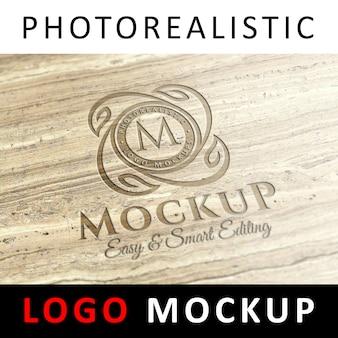 로고 모형-오래된 대리석 표면에 새겨진 로고 프리미엄 PSD 파일