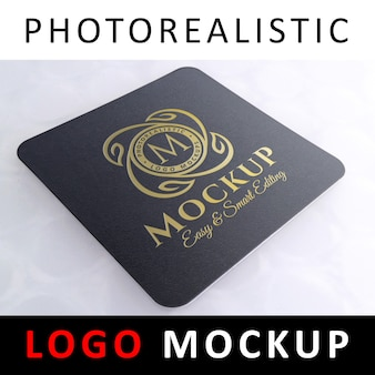 Logo mockup - golden logo on black square coaster