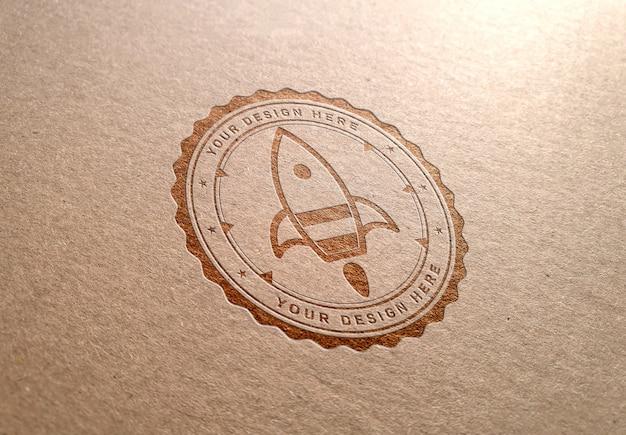 Макет логотипа на картонной текстуре