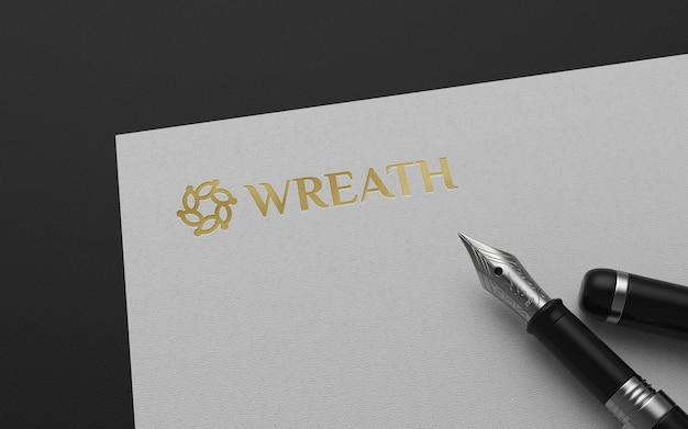 Мокап логотипа на бумаге с перьевой ручкой