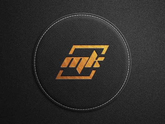 Logo mockup on rounded black leather surface with debossed gold print