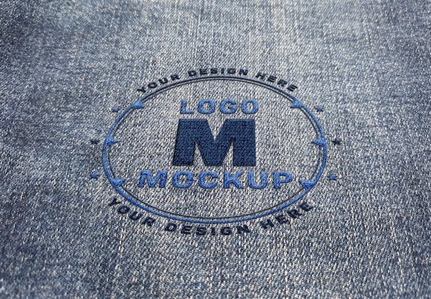 Logo mockup stitched on denim fabric texture