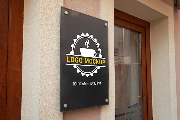 Logo mockup on store entrance wall