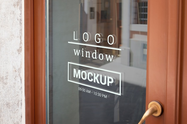 Logo mockup on store front door window