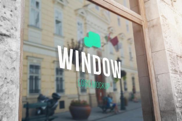 Logo mockup on store glass window Premium Psd