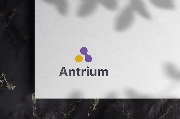 Logo mockup on white paper with shadow overlay