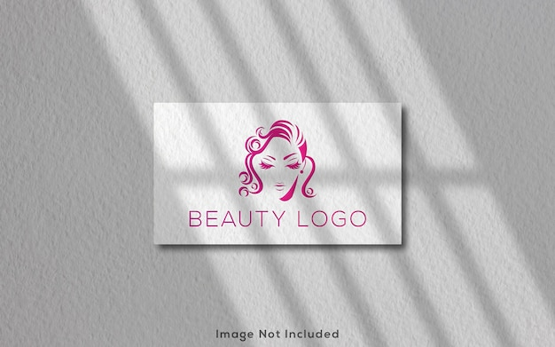 Logo mockup on white white business card with shadow