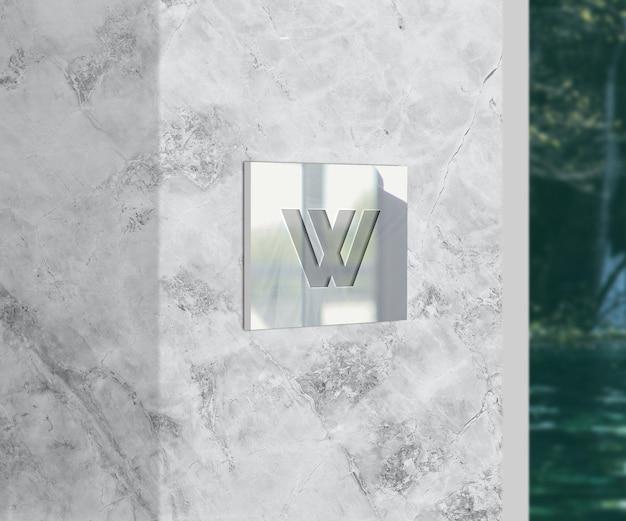 Логотип на стекле и макете текстуры мрамора