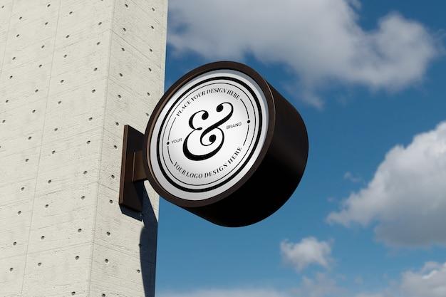 푸른 하늘이있는 외관에 로고 사인 모형 현대 원형 원형 간판
