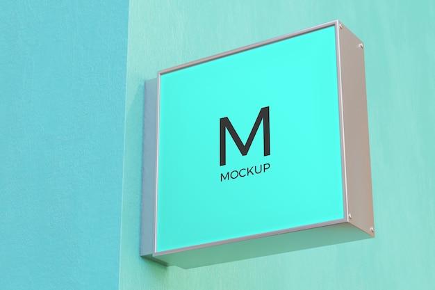Коробка вывесок прямоугольника вывески макета знака логотипа на фасаде