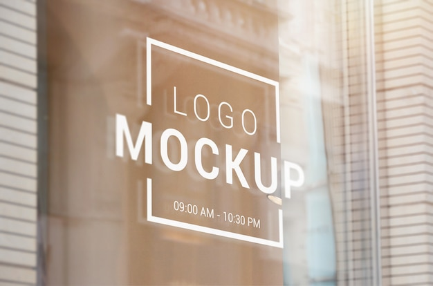 Logo, sign mockup on store glass window. logo branding presentation