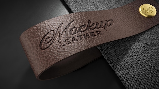 Logotype mockup emboss stamp on a brown leather with gold button