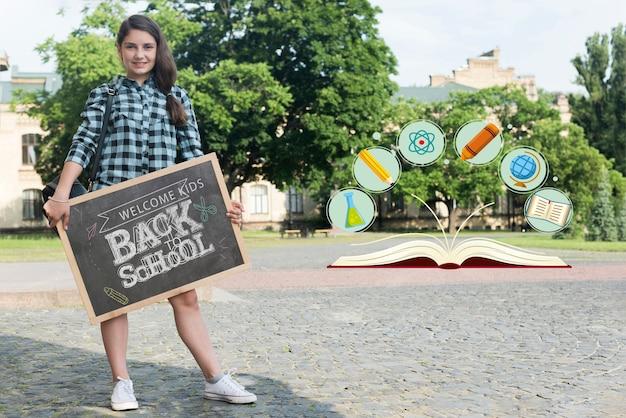 Long shot girl holding a blackboard mock-up