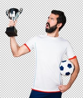 Lucky football player holding a soccer ball