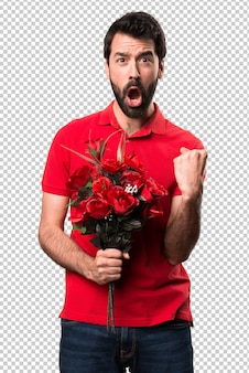 Lucky handsome man holding flowers