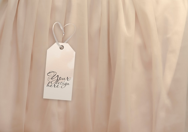 Luggage tag on the background of light beige fabric