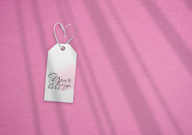 Luggage tag on the background of pink fabric. with shadows