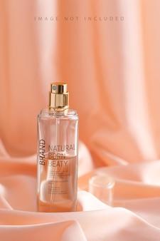 Luxurious perfume bottle on a draped silk fabric in beige tones