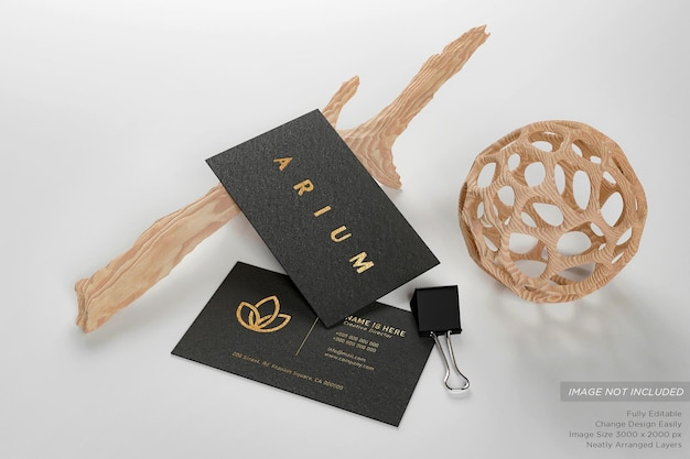 Luxury black business card on the floor with twigs