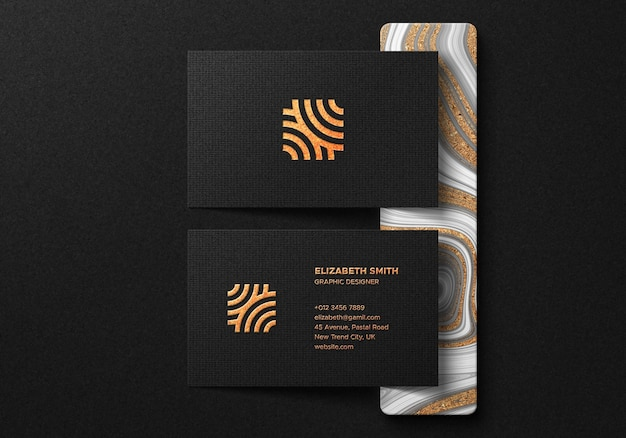 Luxury business card mockup with gold foil effect on dark background