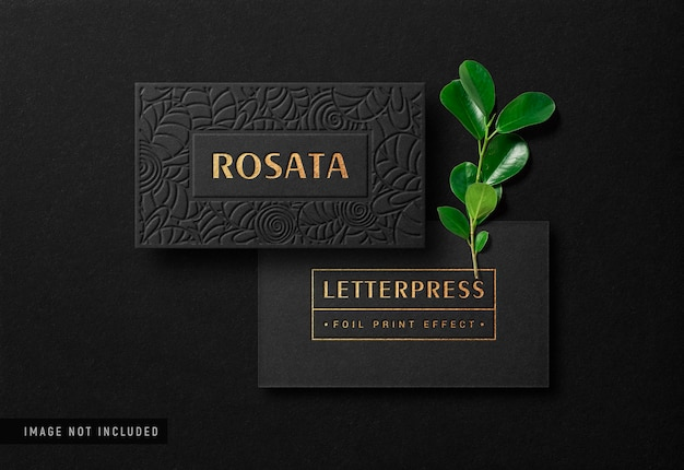 Luxury business card mockup with gold letterpress effect