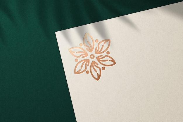 Luxury debossed logo mockup on cream paper premium psd