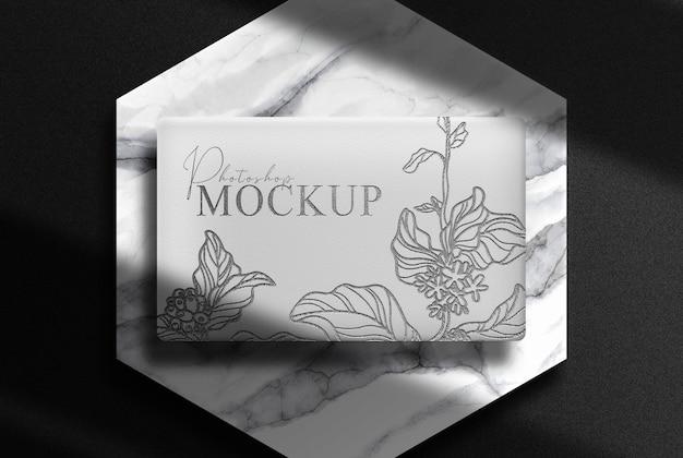 Luxury embossed box with marble podium mockup
