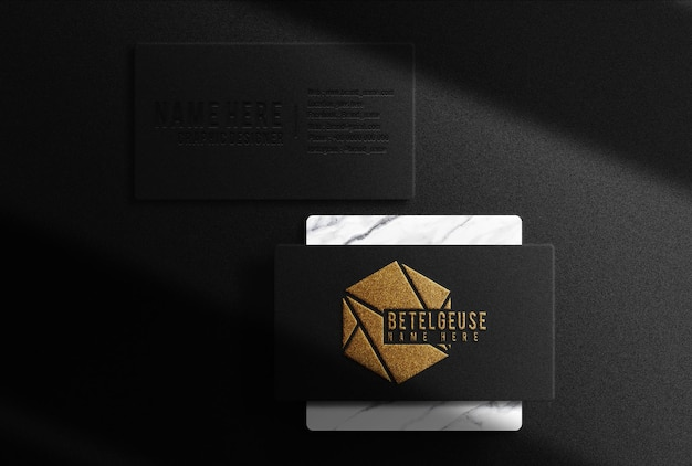 Luxury gold embossed business card top view mockup