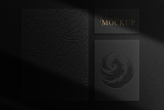 Luxury gold embossed papers top view mockup