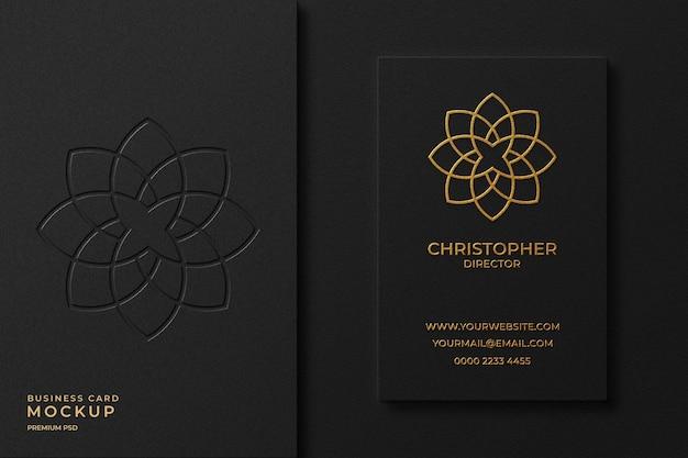 Luxury gold foil business card mockup with letterpress logo on background
