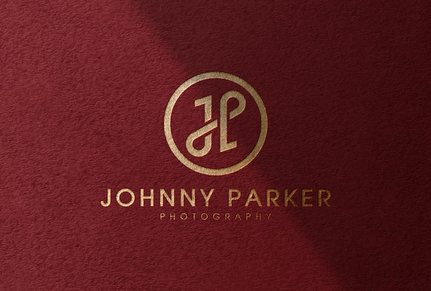 Luxury gold foil logo mockup on red textured paper