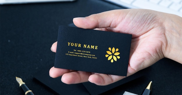 Luxury golden business card mockup holded by man hand