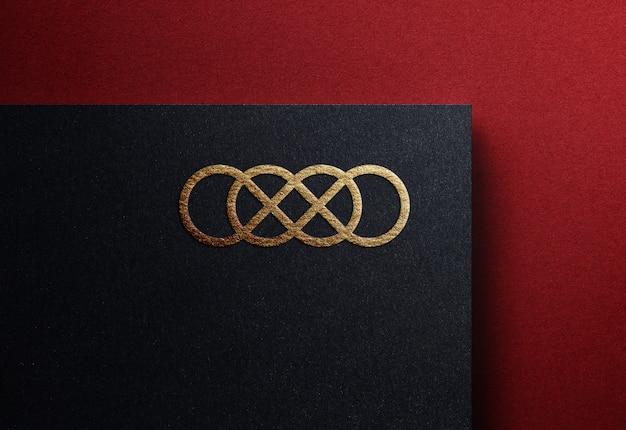 Luxury golden logo mockup on plain black embossed business card