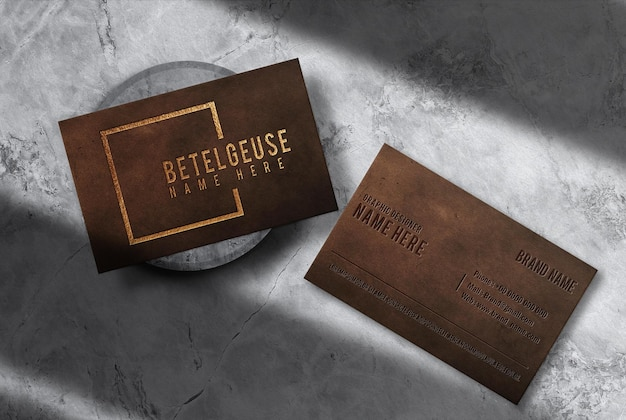 Luxury leather embossed business card top view mockup
