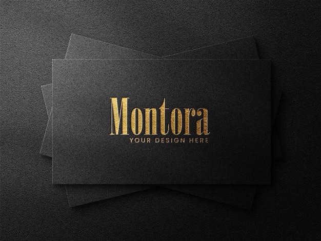 Luxury logo mockup on black business card  and dark background