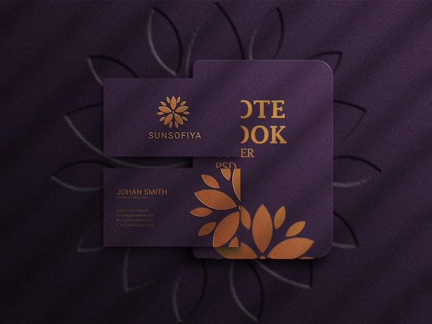 Luxury logo mockup on dark business card with notebook