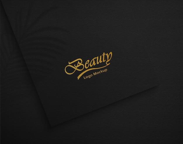 Роскошный макет логотипа на черной текстуре