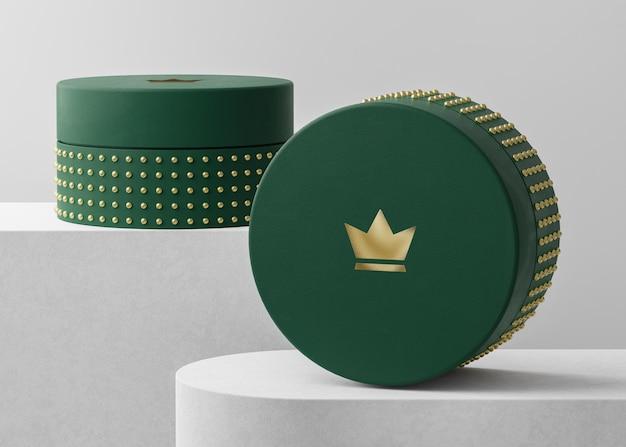 브랜드 아이덴티티 3d 렌더링을위한 녹색 보석 상자에 럭셔리 로고 모형