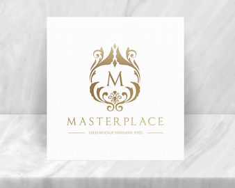 Luxury logo mockup with marble stand background