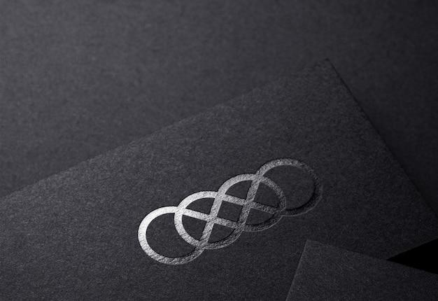 Luxury silver logo mockup on black embossed craft business card
