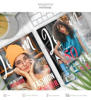 Magazine mockup of two magazine cover designs on marble table