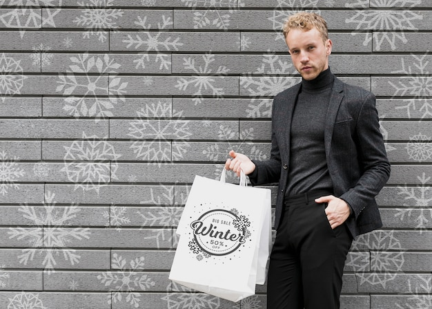 Male in black suit with shopping bags