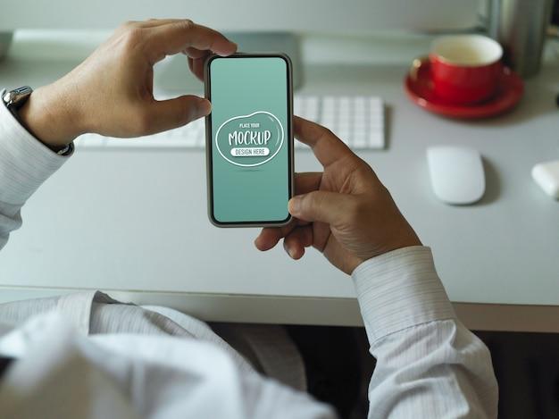 Male showing mockup smartphone screen