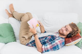 Man at home with tablet mockup