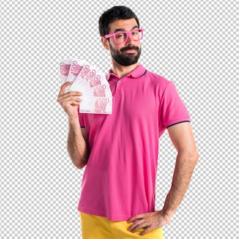 Man in colorful clothes taking a lot of money